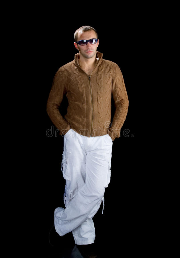 Young man wearing sunglasse. S on a black background royalty free stock photography