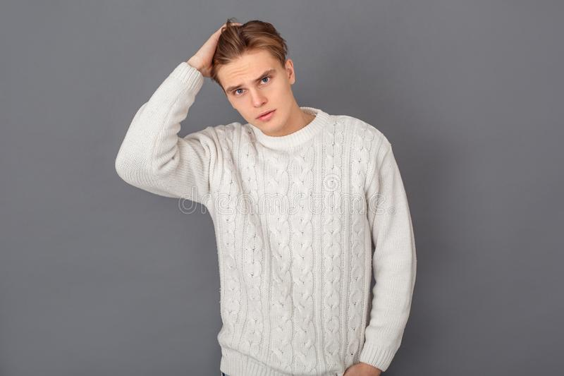 Young man wearing sweater studio isolated on grey handsome royalty free stock image
