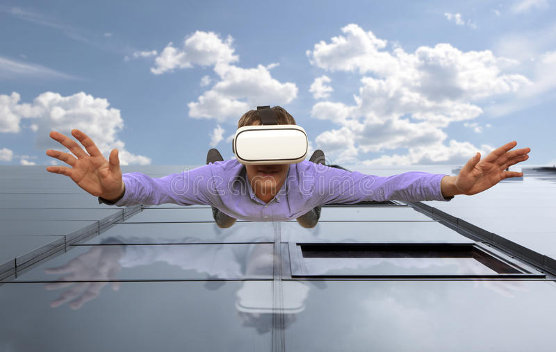 Young man wearing virtual reality glasses flying royalty free stock photos