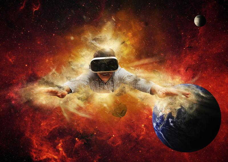 Young man wearing virtual reality glasses royalty free stock image