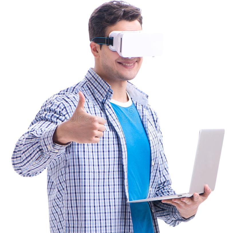 Young man wearing virtual reality VR glasses stock photography