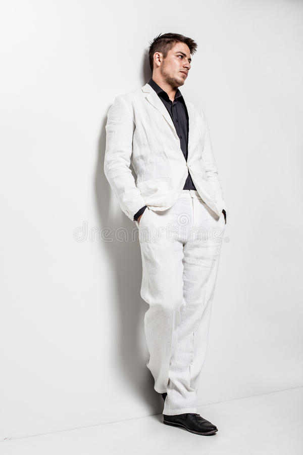 Young man wearing white suit stock images