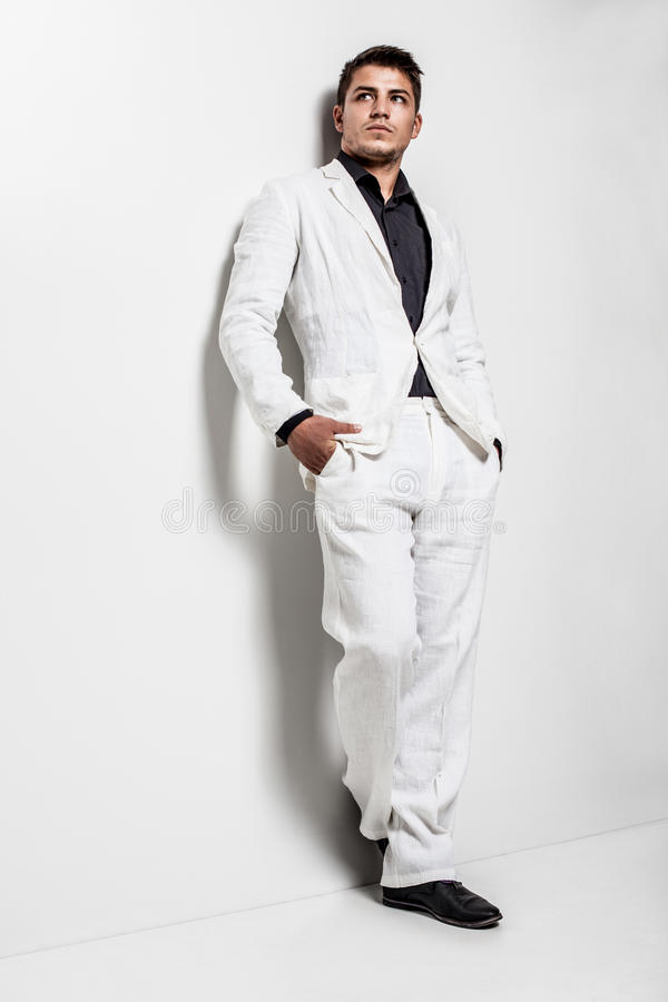Young man wearing white suit royalty free stock image
