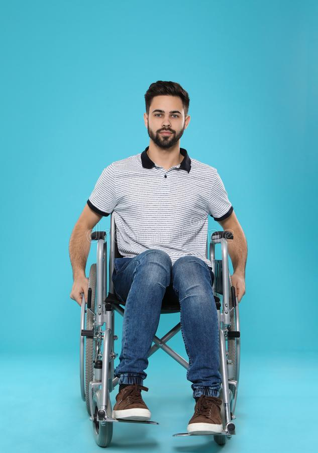 Young man in wheelchair royalty free stock images