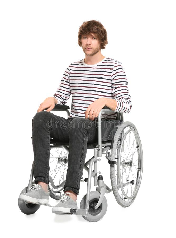 Young man in wheelchair royalty free stock image