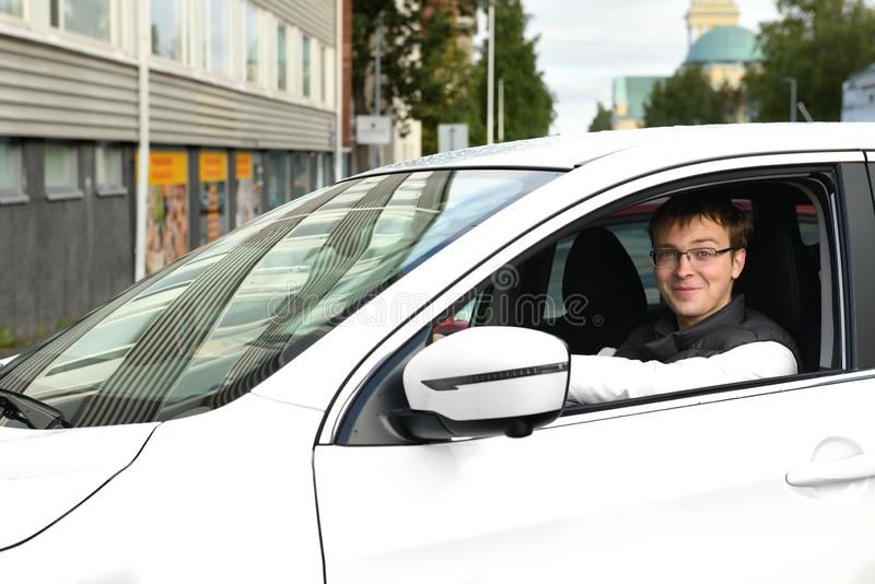 Young man in white car in Oulu, Suomi. Portrait.  royalty free stock image