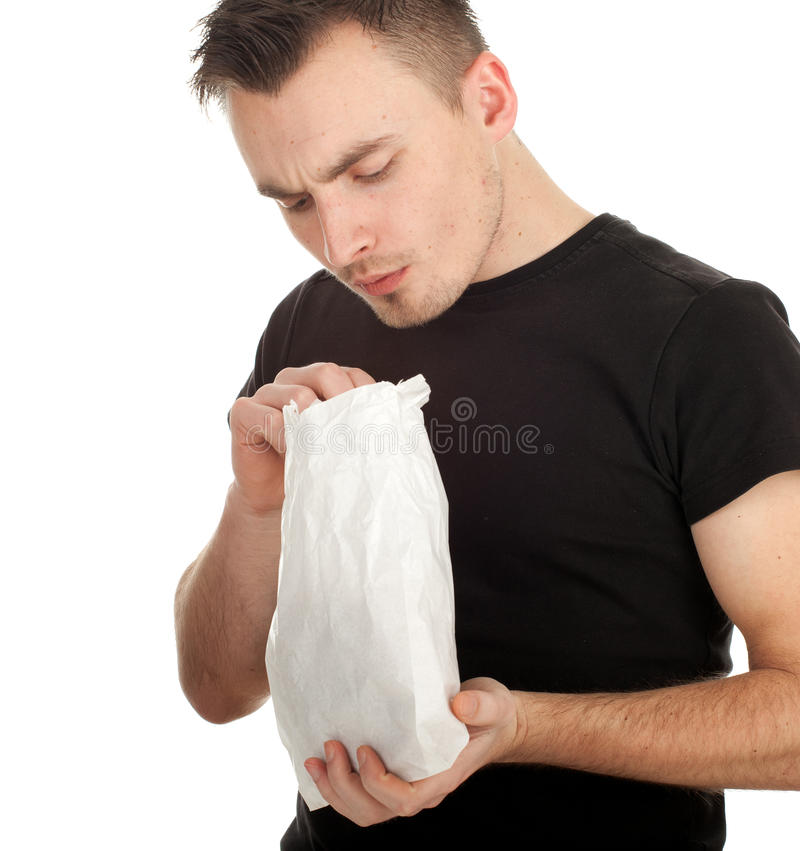 Young Man With White Paper Bag Royalty Free Stock Photos