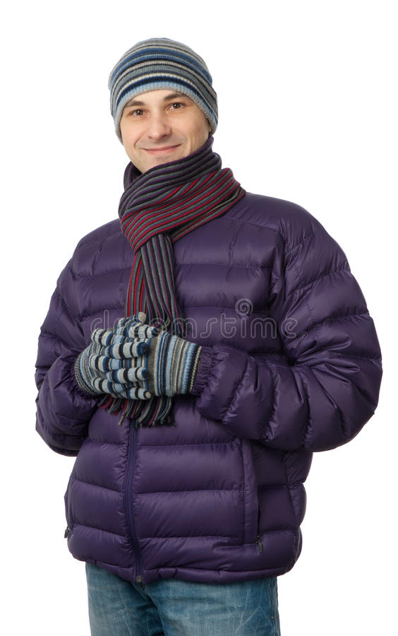 Young man in a winter jacket and scarf royalty free stock photography
