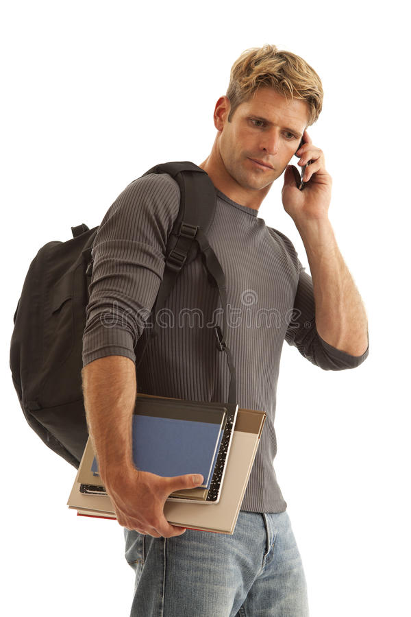 Free Young Man With Books And Backpack On Cell Phone Royalty Free Stock Photo - 17780565