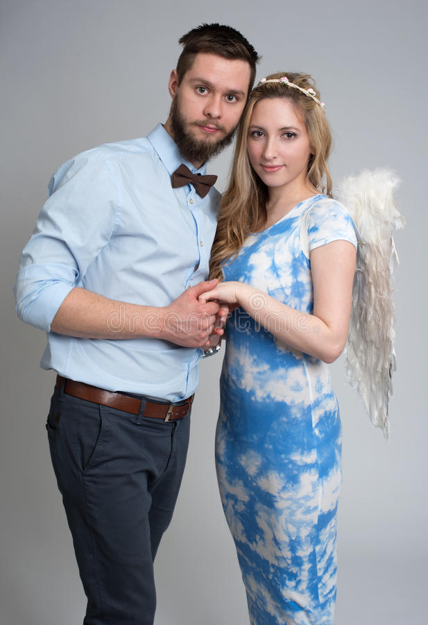 Young man and woman angel royalty free stock image