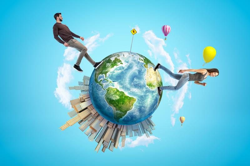 Young man and woman in casual clothes walking on small planet Earth with modern city popping up on one side and hot-air vector illustration