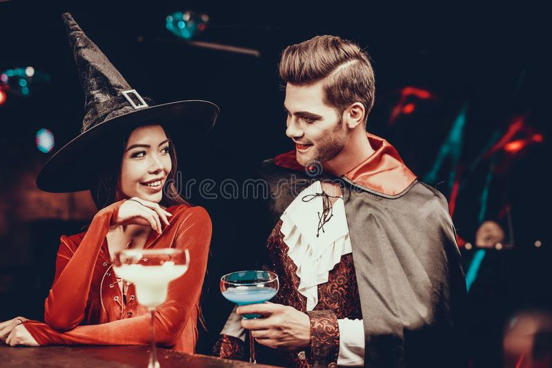 Young Man and Woman in Costumes at Halloween Party stock images