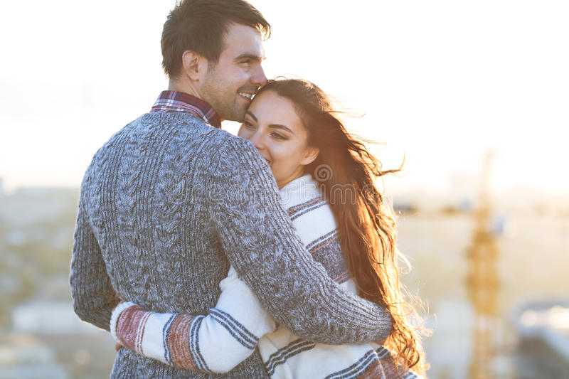 Young man and woman embrace and having fun outdoors. Young men and women embrace and having fun outdoors on the roof& Love and relations concept stock photo
