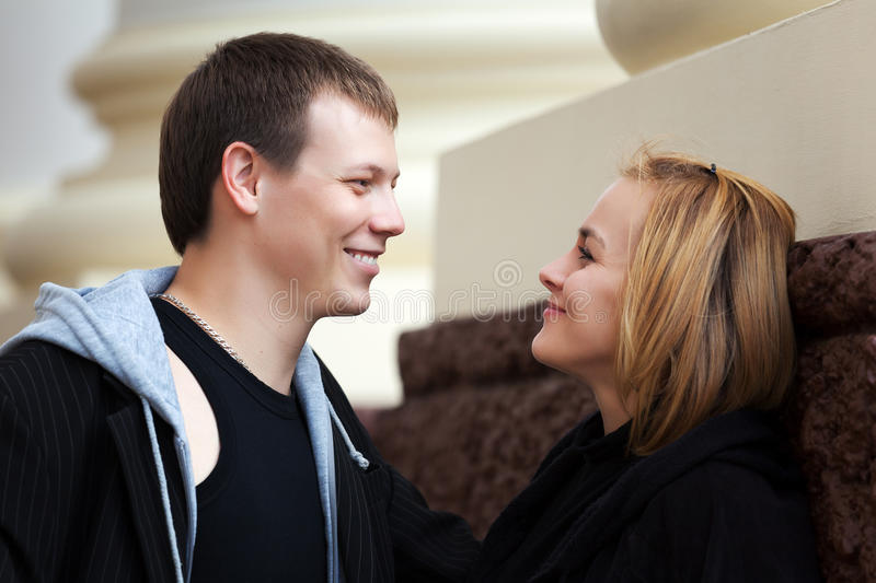 Young man and woman flirting royalty free stock images