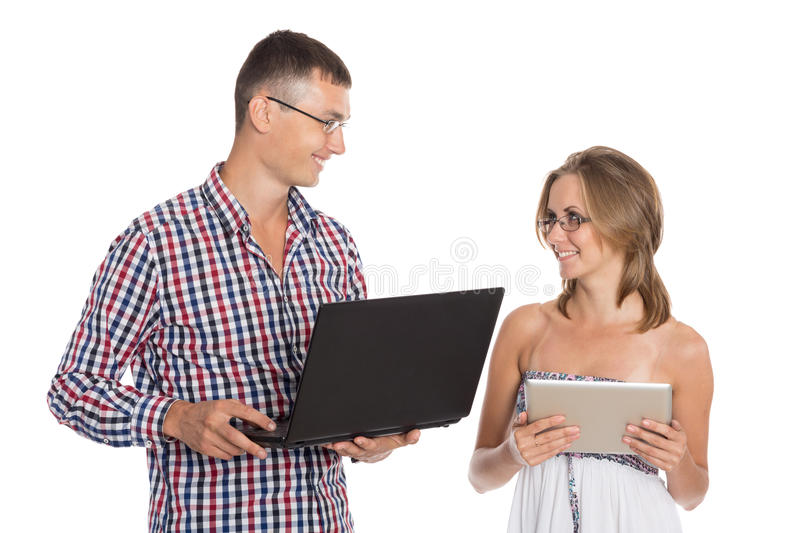 Young man and woman with a PC royalty free stock photos