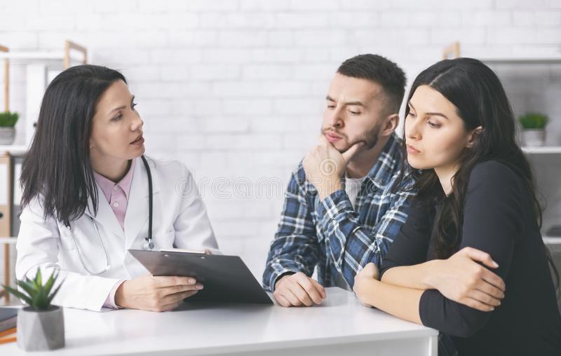 Young man and woman reading doctor`s prescriptions for infertility cure. Treatment plan. Young men and women reading doctor`s prescriptions for infertility cure royalty free stock image