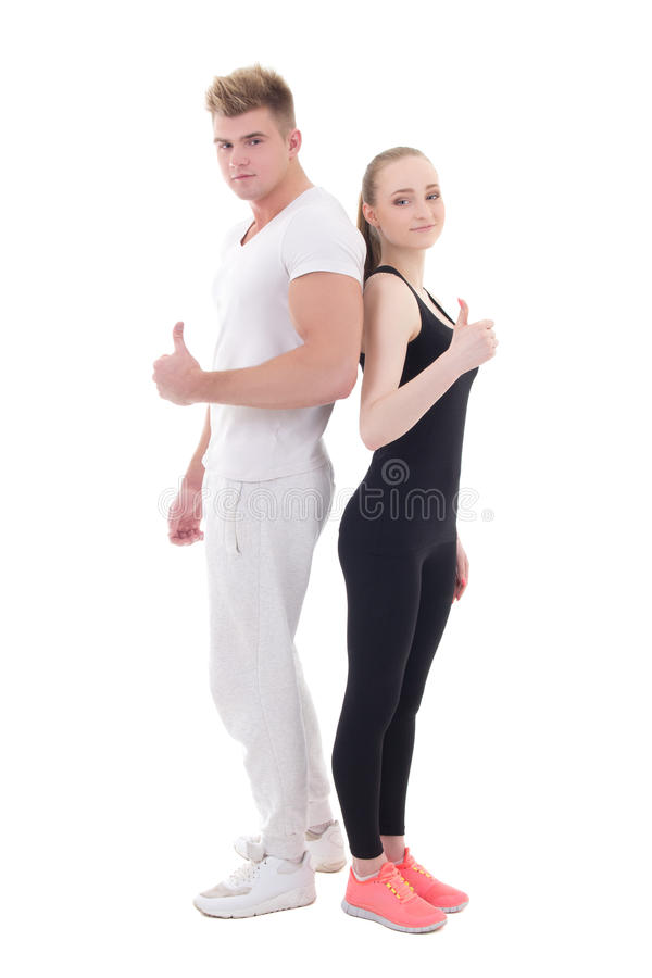 Young man and woman in sportswear thumbs up isolated on white royalty free stock photography