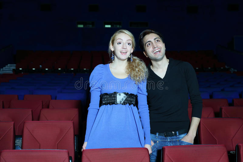 Download Young Man And Woman Stand, Watch Movie And Laugh Stock Image - Image of happy, happiness: 33777475