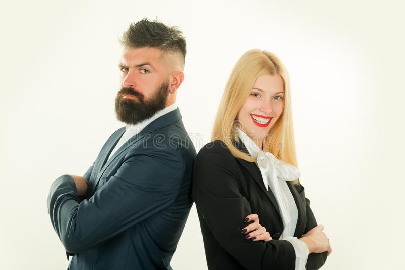 Young man and woman standing back-to-back with crossed hands against white background. Business man concept. royalty free stock photos