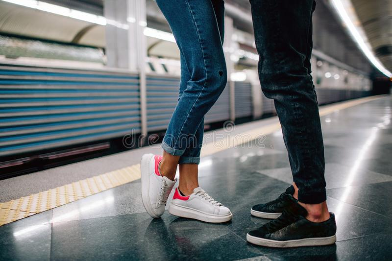 Young man and woman use underground. Couple in subway. Cut view of man and woman stand in front of each other. Fast royalty free stock images