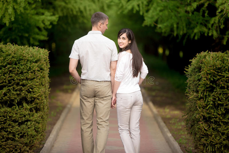 Young man and woman walking outdoor royalty free stock images