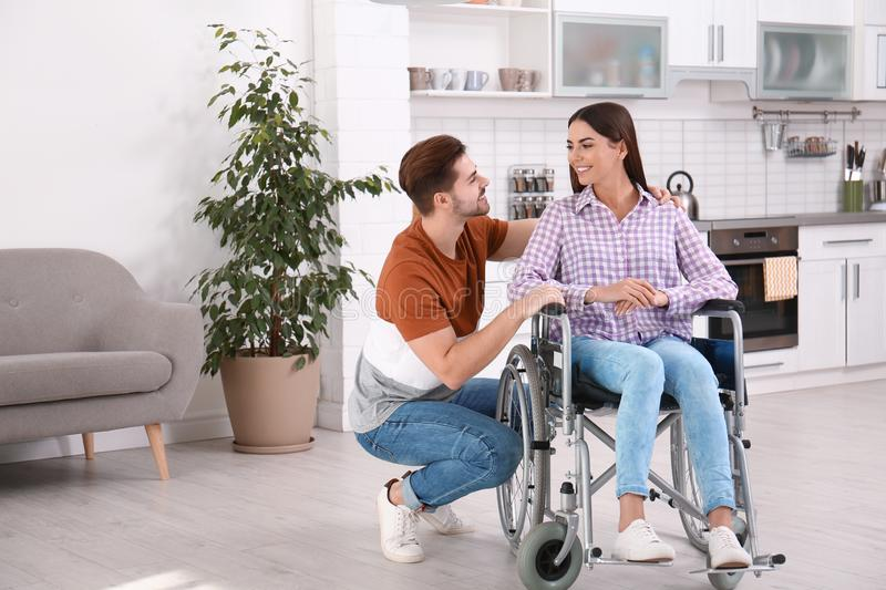 Young man with woman in wheelchair royalty free stock image