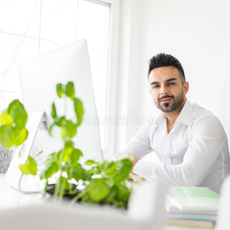 Young man and woman working in office stock images