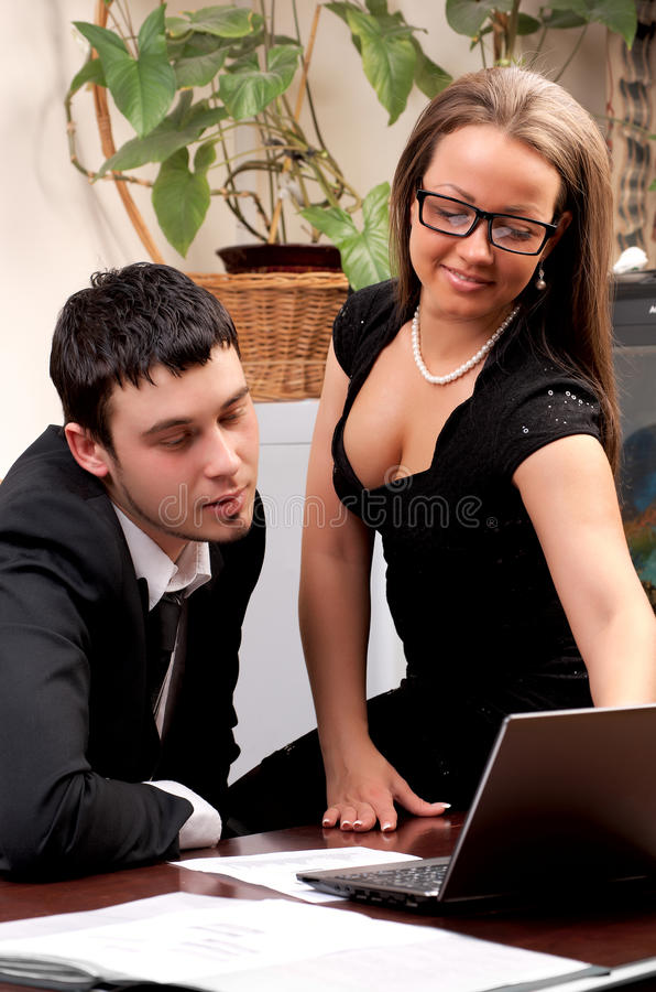 Young man and woman working together. In office royalty free stock photos