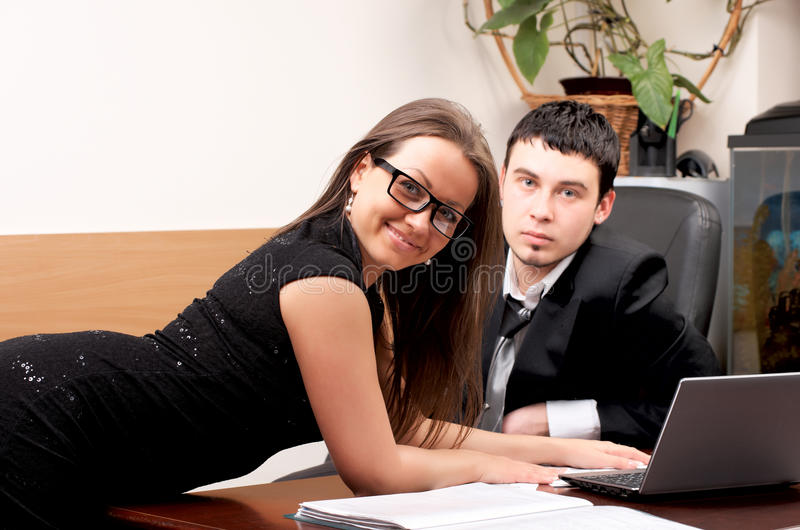 Young man and woman working together. In office royalty free stock images