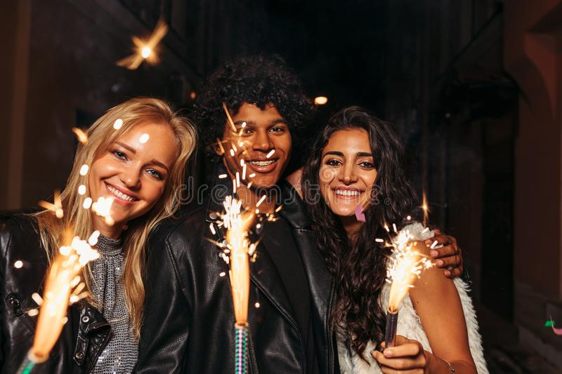 Young man and women enjoying new years eve stock image