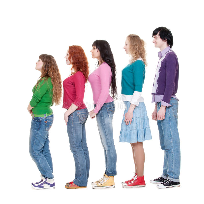 Young man and women in turn. Full length portrait of young man and women in turn against white background stock photo