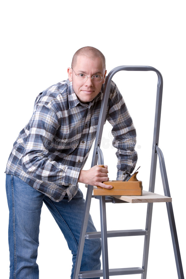 Young man with a wood plane. Full isolated studio picture from a young man with a wood plane stock image