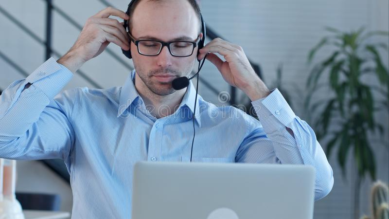 Young man working in a call centre royalty free stock photography
