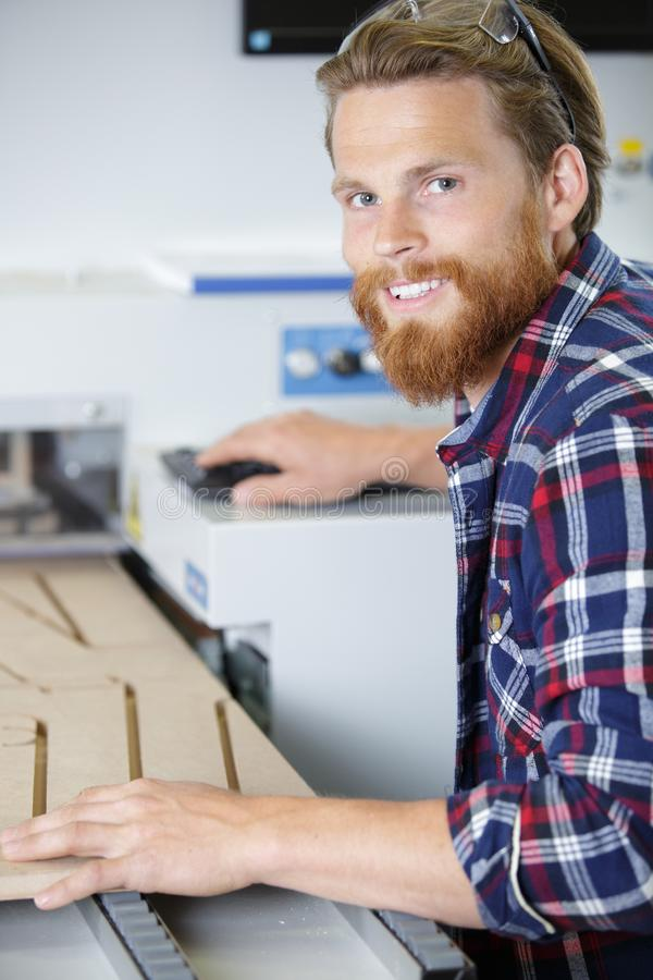 Young man working in carpenting studio royalty free stock photography