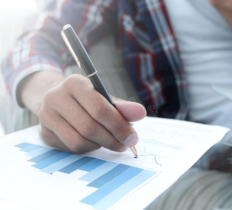 Young man working with financial documents at home royalty free stock image