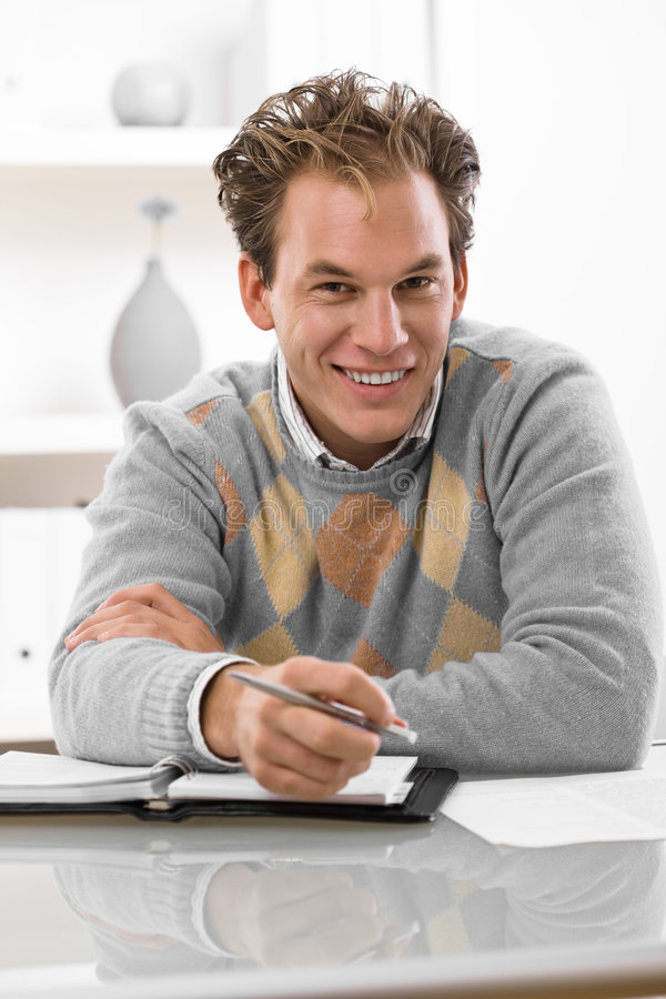 Young Man Working At Home Stock Photos