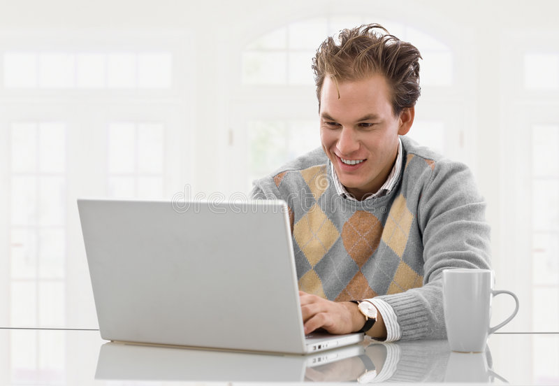 Download Young man working at home stock image. Image of indoor - 8503503