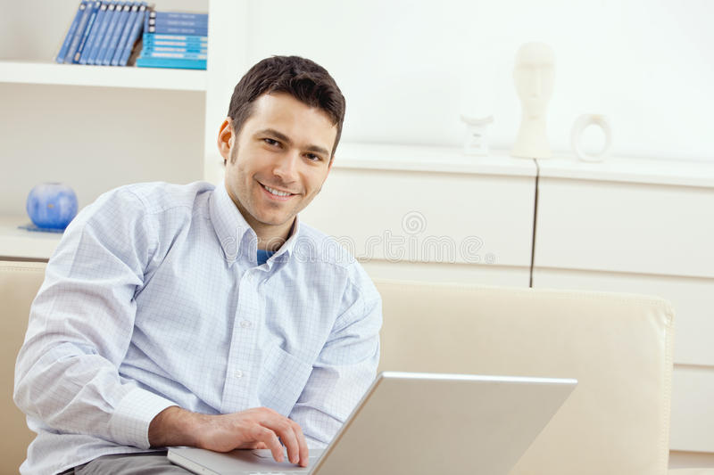 Download Young man working at home stock photo. Image of house - 9413640