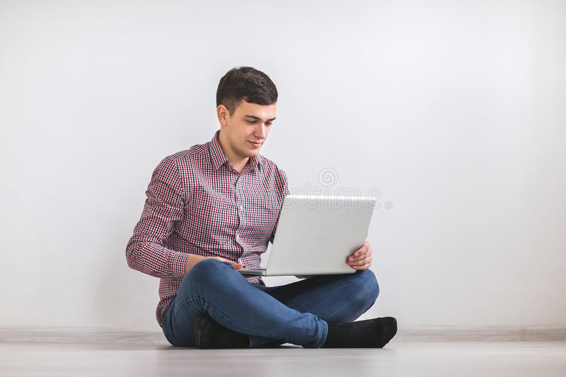 A young man working on a laptop stock photography