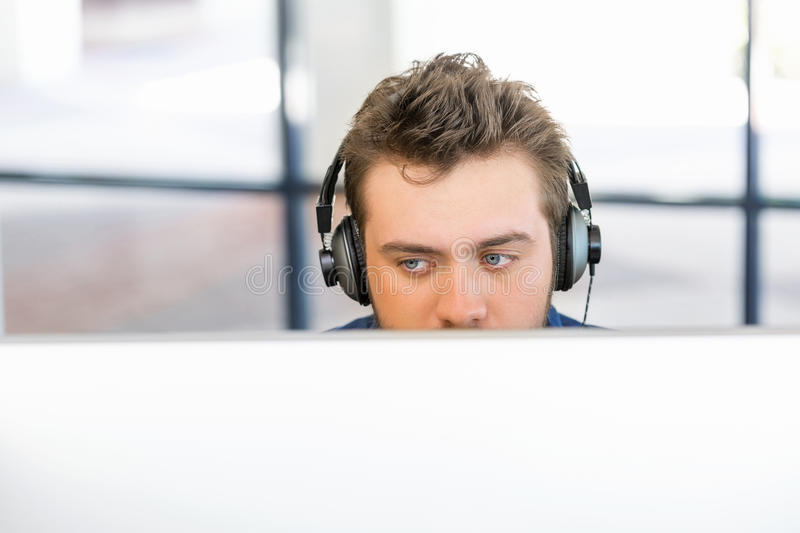 Young man working in office stock photography
