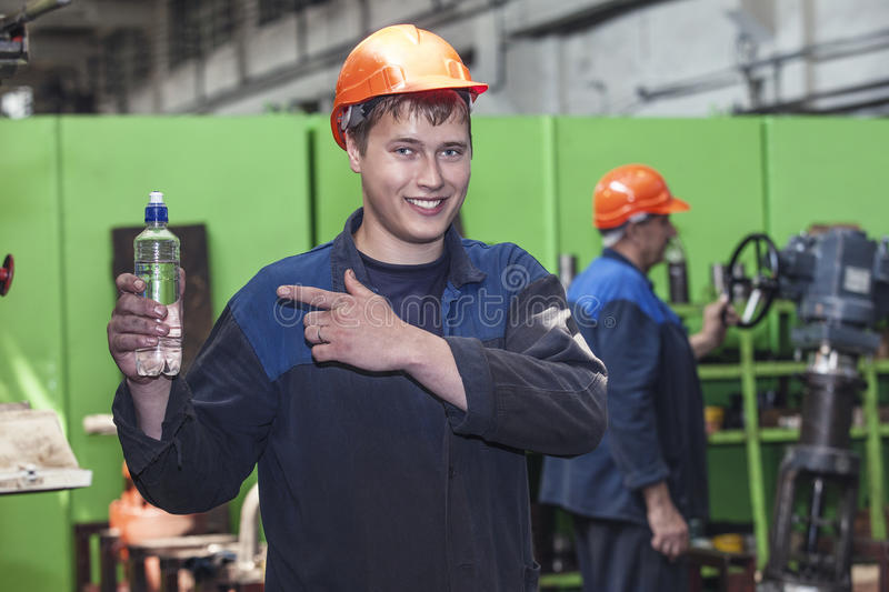 The young man working at the old factory on installation of equipment royalty free stock images