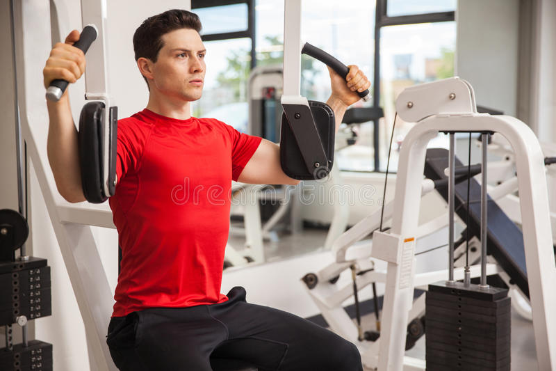 Young man working out at the gym stock images