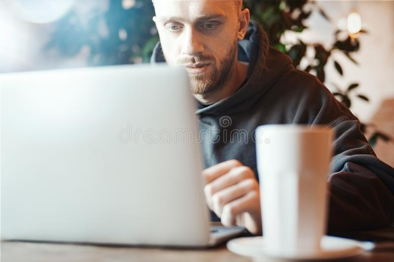 Young man working on PC pc in co-working stock images