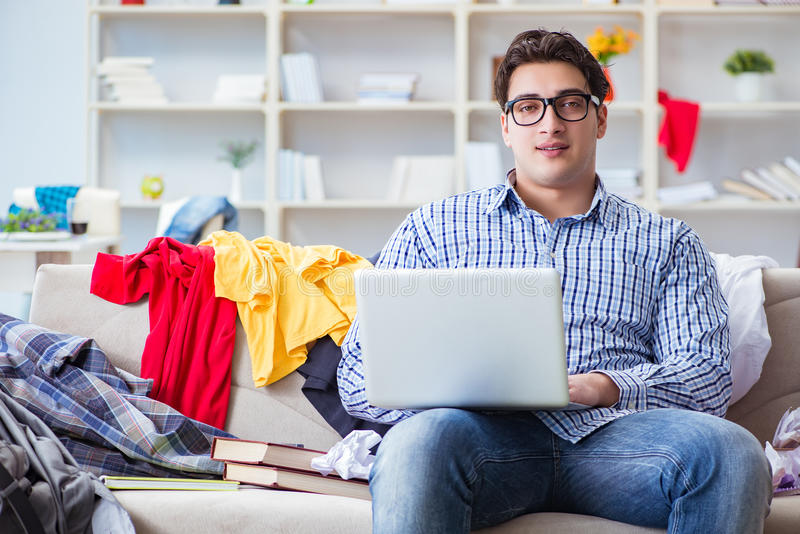 The young man working studying in messy room stock photography