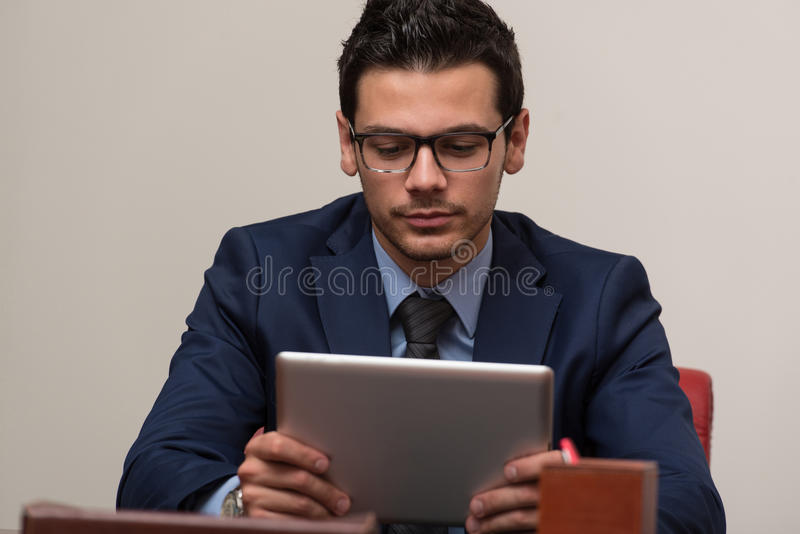 Download Young Man Working On Touchpad In Office Stock Photo - Image: 43253307