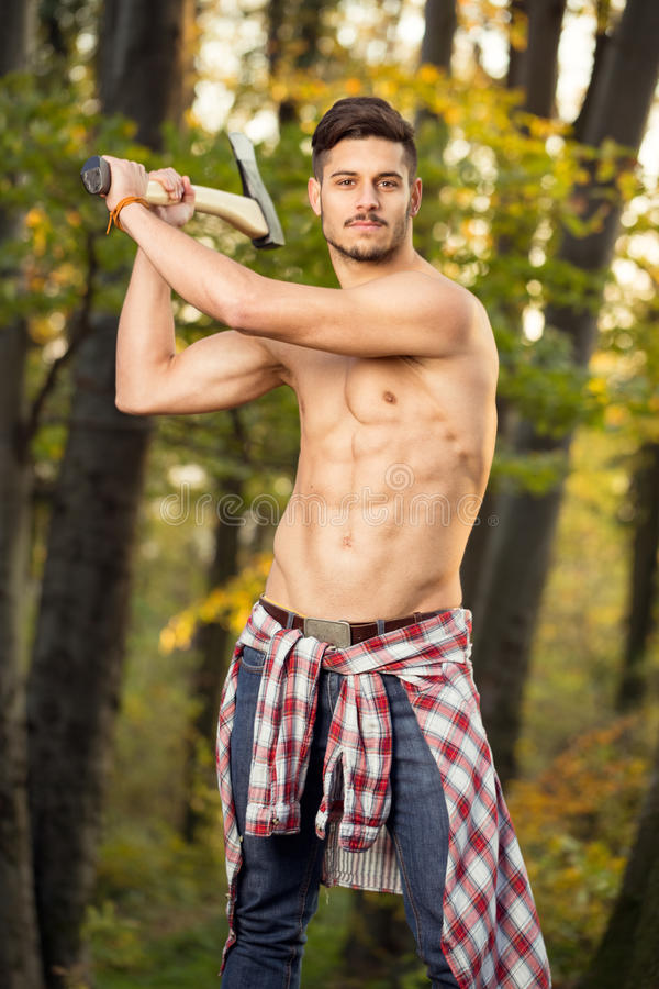 Free Young Man Working With Axe Royalty Free Stock Photography - 37154077