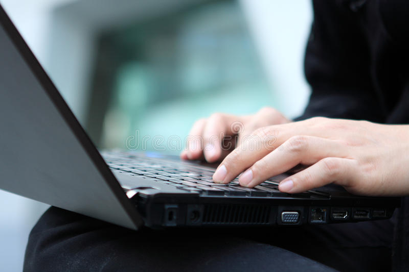 Young man works for a laptop royalty free stock photos