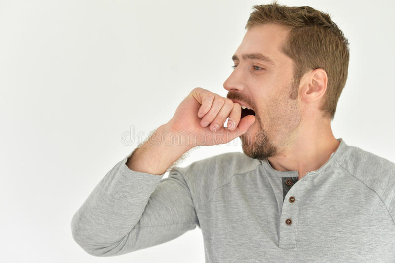 Young man yawing. Portrait of a young man yawing, tired stock image