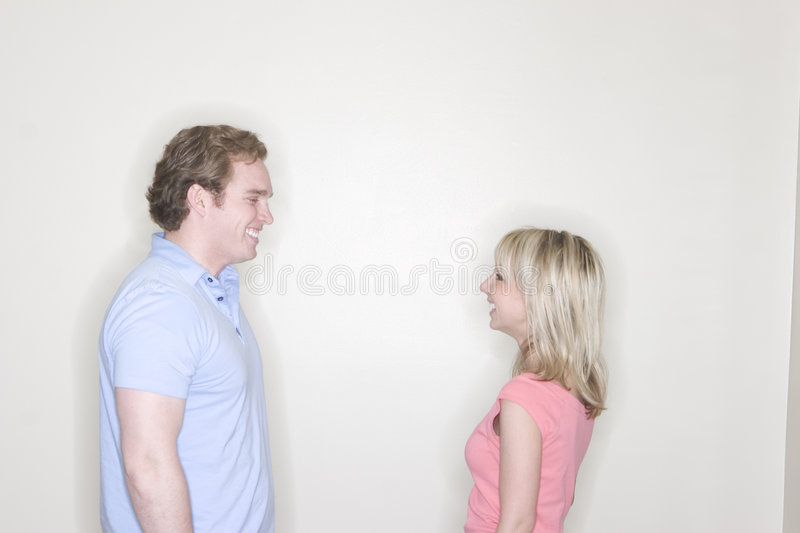 Young man and young woman royalty free stock photo