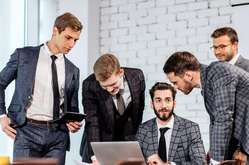 Young manager or boss talk with co-workers stock image